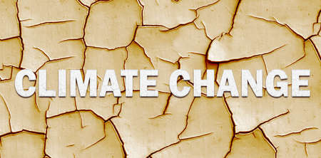 Climate change banner with CLIMATE CHANGE lettering over dry cracked mud in a concept of the effect of Global Warming on the planet