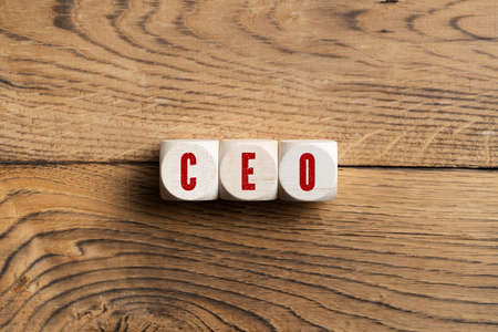 CEO spelled in red on three wooden blocks on wood surface