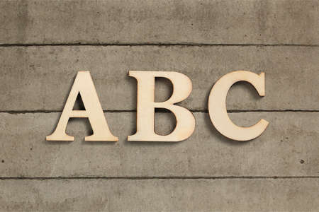 Rustic old ABC alphabet letters on wood in a concept of learning and education