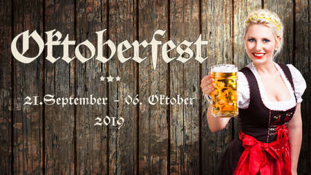 message Oktoberfest - Sep 21. - Oct 06. 2019 in German beautiful woman in a traditional bavarian dirndl holding a beer in front of wooden background