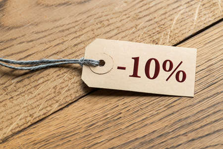 "Hangtag with title ""-20%"" on wooden background"