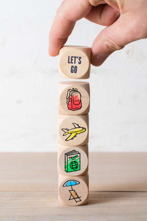 Message Lets go! depicting online travel concept with travel icons on wooden background Stock Photo
