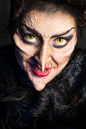 close up of scary old witch on dark background
