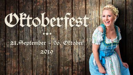 message Oktoberfest - Sep 21. - Oct 06. 2019 in German beautiful woman in a traditional bavarian dirndl in front of wooden background Zdjęcie Seryjne