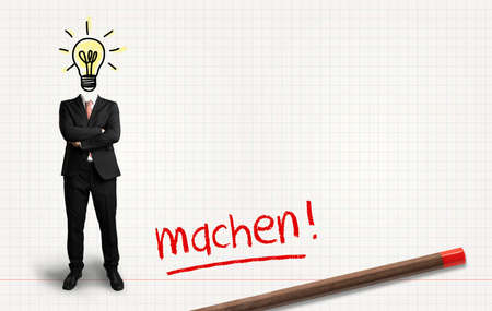 headless businessman with idea and the German word for do on paper background 版權商用圖片