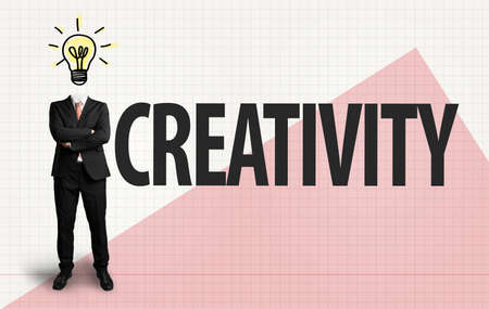 businessman with lightbulb as a head and the word creativity on paper background