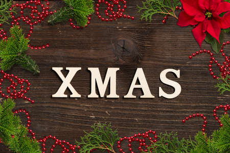 classic christmas decoration and the word XMAS  on wooden background 版權商用圖片