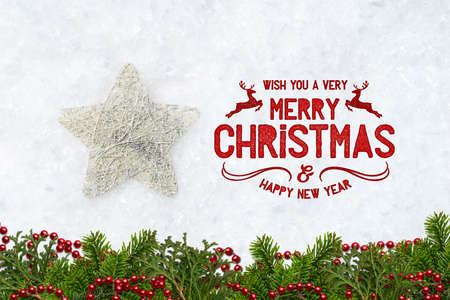 decorative star in decorative snow with merry christmas message