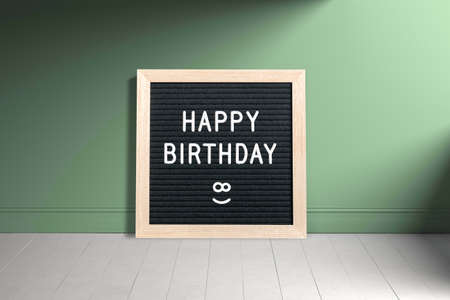 letter board with message happy birthday in an empty room