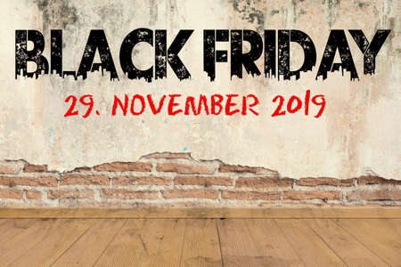 text Black Friday and date in 2019 on a brick wall