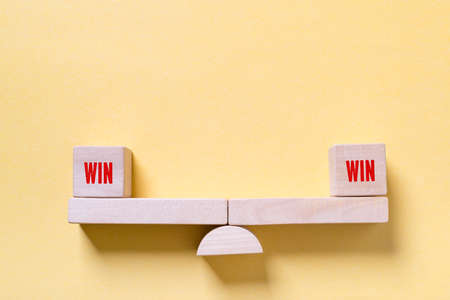 win-win balance simbolized with toys on paper background