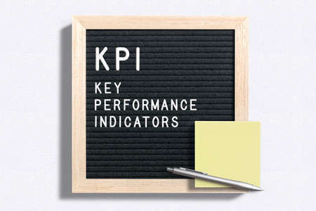 letter board with message KPI - Key performance indicators on white background