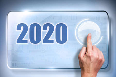 finger presses a button with a loading bar on a touchscreen to load up 2020 Stock fotó