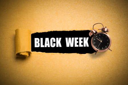 torn paper reveals Black Week on black background
