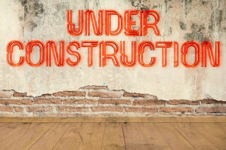 """concrete wall with message """"under construction"""""""