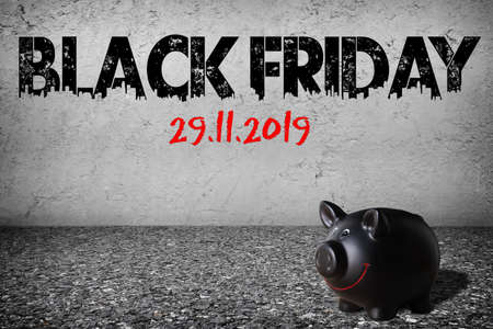 text Black Friday and date in 2019 on a concrete wall