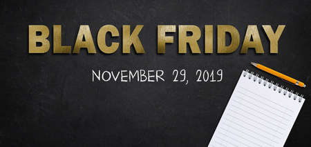 text Black Friday in golden letters with 2019 date and notepad on black background Stock fotó