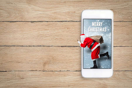 Santa Claus running out of a smartphone and
