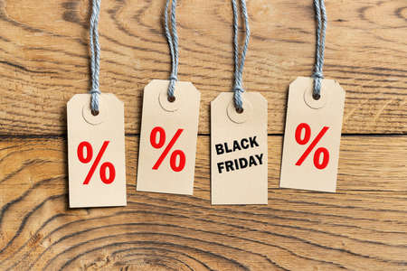 Hangtags with text Black Friday on wooden background Stock fotó