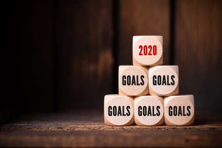 cubes with the word goals and the number 2020 on wooden background Stock Photo