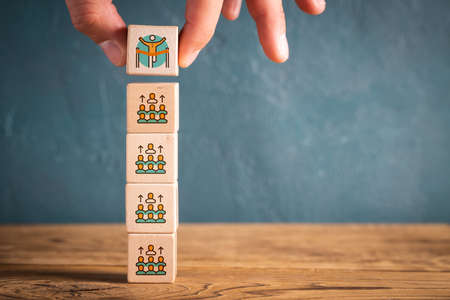 election process shown as symbols on cubes on wooden background
