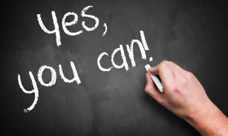 """hand writing """"yes, you can!"""" with chalk on a blackboard"""