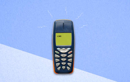 classic feature phone on paper background