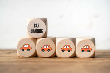 cubes with  car sharing symbols on wooden background 写真素材 - 140389556