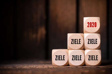 cubes with the word goals in German and the number 2020 on wooden background Stock Photo