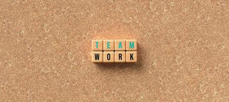 cubes showing the message TEAMWORK on cork background - 3D rendered illustration 写真素材
