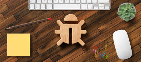 bug icon on wooden desktop with office items viewed from above