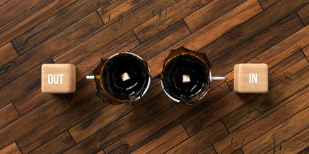 cups of coffee and cubes with text OUT and IN on wooden background - 3D rendered illustration 写真素材