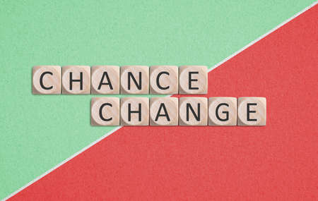 twelve cubes with letters, showing the words CHANGE and CHANCE on paper background