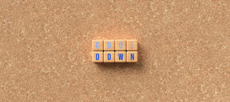 cubes with words COOL DOWN in blue letters on a cork board - 3D rendered illustration 写真素材 - 140389606