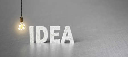 lightbulb and word IDEA on brushed aluminum background - 3D rendered illustration