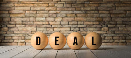 wooden balls with the word DEAL in front of a brick wall on wooden floor - 3D rendered illustration 写真素材 - 140389613