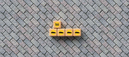 cubes with car symbol and text TAXI on stone background - 3d rendered illustration