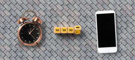 smartphone and cubes with car symbol and text TAXI on stone background