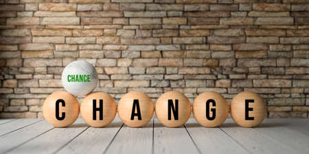 wooden balls with letters showing the words CHANGE and CHANCE in front of a brick wall on wooden floor - 3d rendered illustration 写真素材