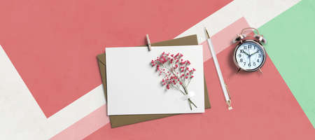 flower, a clock and a letter on paper background