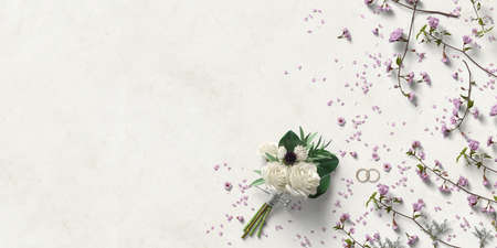 bouquet of flowers and rings with decorative flower petals on paper background 写真素材