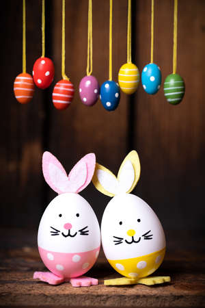 Easter Eggs with bunny ears on wooden background 写真素材