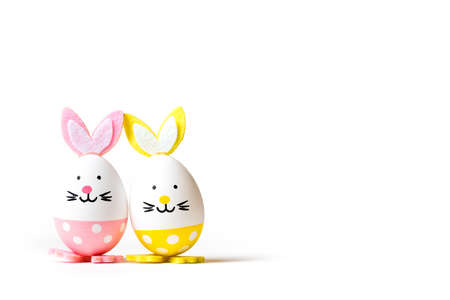 Easter Eggs with bunny ears on white background