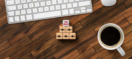 cubes with message FLIGHT CANCELLED in front of a computer keyboard on wooden background