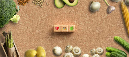 many cooking ingredients and cubes with health symbols on cork background