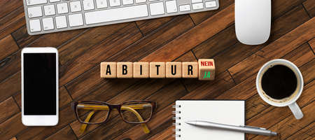 cubes with the German name ABITUR as university-entry qualification and YES or NO option on wooden background Stok Fotoğraf