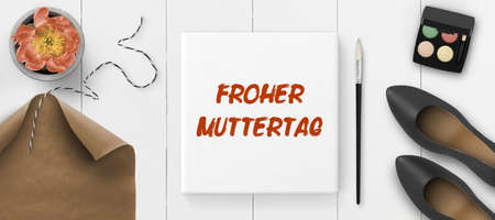 white canvas with message HAPPY MOTHER'S DAY in German on white painted wooden background