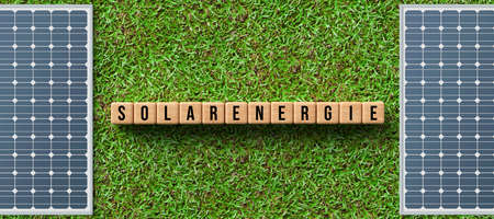 solar panels on green grass and cubes with German message for SOLAR ENERGY - 3D rendered illustration
