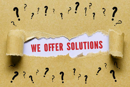torn paper with many question marks revealing the message WE OFFER SOLUTIONS