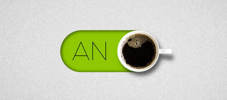 cup of coffee and German text for ON on bright paper background